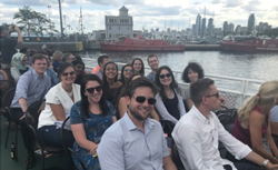 2018 summer associates learn about Chicago Architecture during a river boat tour.